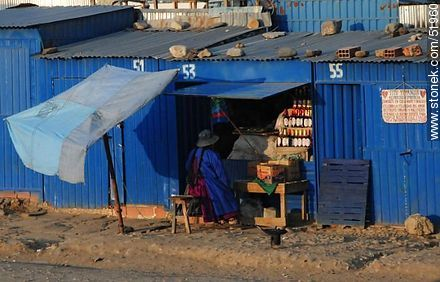 El Alto. Shops painted in blue. - Photos of El Alto - Bolivia - Others in SOUTH AMERICA. Image #51960