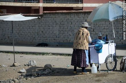 Peddler with umbrella - Photos of El Alto - Department of La Paz, Others in SOUTH AMERICA. Image #52769