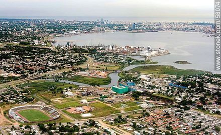 Aerial view of Cerro stadium, Pantanoso creek and the PTI Industrial Technology Park - Aerial photos of Montevideo - Department and city of Montevideo - URUGUAY. Image #58074