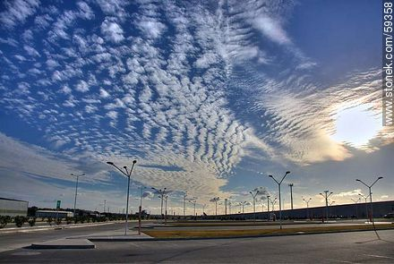 Airport parking with cirrus in the sky - Photos of the International Airport of Carrasco - Km 20, Route 101, URUGUAY. Image #59358