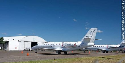 Private jets at the airport in Punta del Este C / C Carlos Curbelo - Photos of Laguna del Sauce, URUGUAY. Image #62012