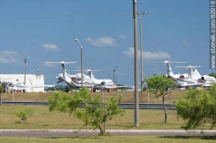 Private jets at the airport in Punta del Este C / C Carlos Curbelo - Photos of Laguna del Sauce, URUGUAY. Image #62016