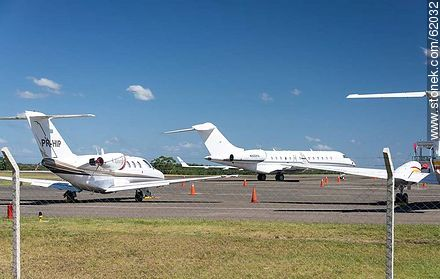 Private jets at the airport in Punta del Este C / C Carlos Curbelo - Photos of Laguna del Sauce, URUGUAY. Image #62032