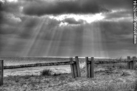 Rays of sun peeking through clouds - Photos in Black and White. - MORE IMAGES. Image #62184