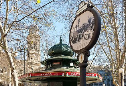 Ancient poster and kiosk with the background of the Metropolitan Cathedral - Photo of Constitucion(Matriz) square and surroundings - Department and city of Montevideo - URUGUAY. Image #64859