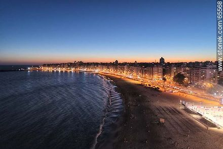 Aerial view at dusk of the rambla and beach Pocitos - Aerial photos of Montevideo, URUGUAY. Image #65568