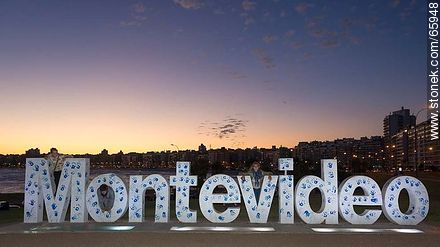 Montevideo in letters painted with footprints at sunset - Photos of Pocitos quarter - Department and city of Montevideo - URUGUAY. Image #65948