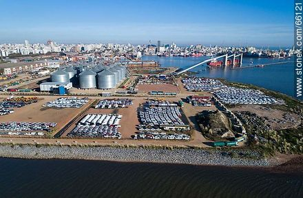 Aerial photo of the port. Silos and imported vehicles.  Row of trucks with grains. - Photos of the Port area - Port of Montevideo, URUGUAY. Image #66121