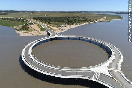 Aerial view of the circular bridge over Laguna Garzón - Photos of Garzon lagoon - Department of Rocha - URUGUAY. Image #66532