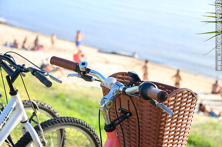 Bicycle basket on the beach - Photographic stock - MORE IMAGES. Image #69383