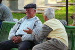 Photo #34895 - Old men talking in a square