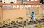 Photo #51842 - Bolivian Peasant walking along railroad tracks