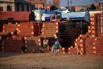 Photo #51972 - El Alto. Bolivian women sit chatting on blocks of brick. Altitude: 3970m