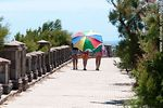 Photo #55088 - Girls walking along the promenade of Punta Fría under an umbrella