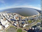 Photo #64557 - Aerial photo of Playa Mansa, bus terminal buildings and Punta del Este, Santos Dumont and promenade towers Williman