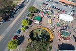 Photo #66331 - Aerial view of the Rodó Park playground. The Gusano loco (Crazy Worm), the helicopters and the carousels.