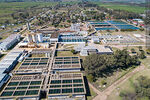 Photo #68312 - Aerial view of the town and OSE's water treatment plant