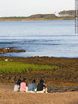 Photo #17131 - Young people enjoying the view of Mansa beach and Gorriti Island